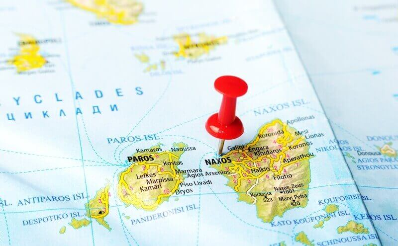 Close up of Naxos island Greece map with red pin