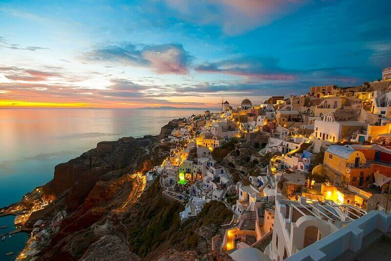 Romantic sunset colors in Oia village on the Greek island of Santorini
